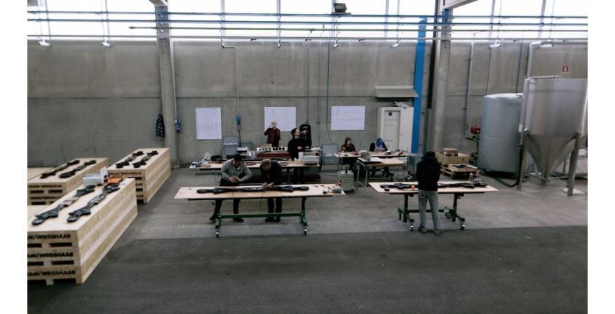 Workers fitting the table with intelligent features.