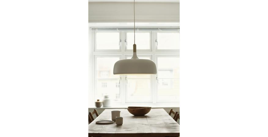 Part of the Stratos Collection, the Acorn pendant by designer Atle Tveit merges oak and painted aluminum to create a clean, warm modern look. The fixture measures 18-3/4 inches in diameter and 13-1/2 inches tall, and it comes in either white or gray. Global Lighting is the exclusive North American distributor of Acorn.