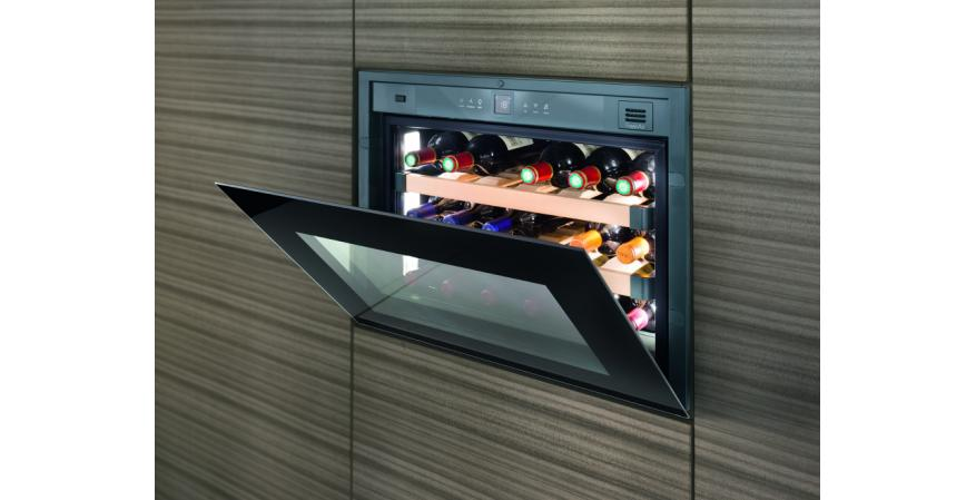 Because luxury kitchens prefer their appliances handle free, Liebherr's HWg 1803 wine storage cabinets partially open with a tap on the glass door. If inactive for three seconds, the door automatically closes. Designed to be installed in 17½-inch niches, the units feature beech-wood telescoping shelves for storing up to 18 bottles, reversible hinges for flexible mounting, and an LCD control screen