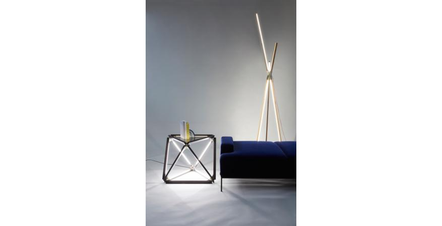 An X Light table, made with 2-foot Stickbulbs and a bronzed-glass top, alongside a 9-foot-tall Big Bang floor lamp.