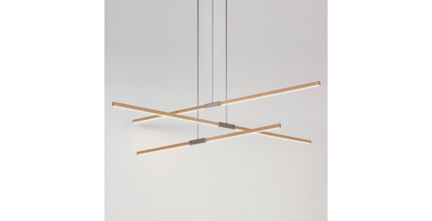 The Multiple Pendant pairs three linear pendants, each consisting of a central piece of hardware joining two Stickbulbs, in a shared canopy. The lights can be configured for uplighting or downlighting.