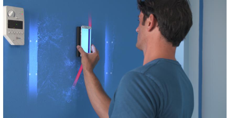 Vayyar Imaging WalabotDIY 3D imaging sensor tool scanning a wall