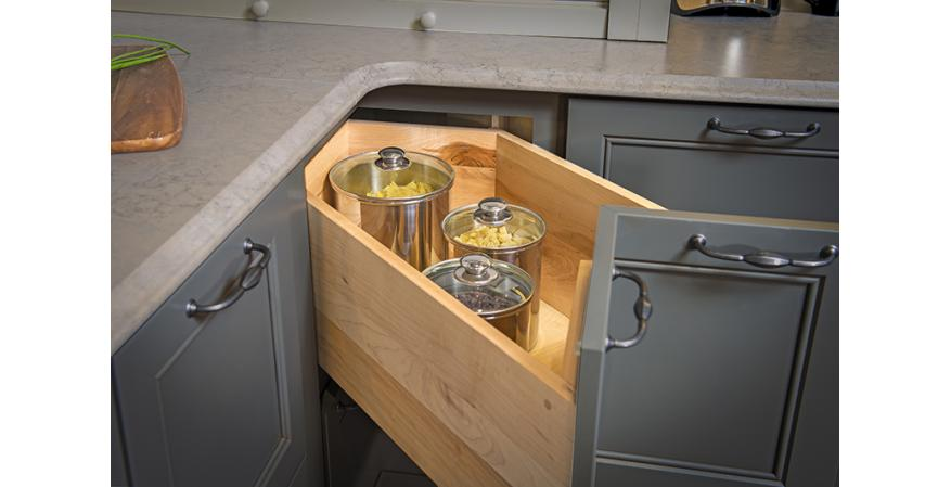 Pulled out corner cabinet drawer