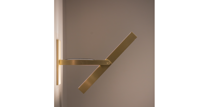 Douglas Fanning has released a new collection of wall-mounted brass light fixtures that pivot from vertical to horizontal.