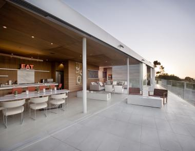 San Diego-based Safdie Rabines Architects opted for Solana concrete floor tiles from Concrete Collaborative to create a seamless flow from the inside to the outside of this La Jolla, Calif., home.