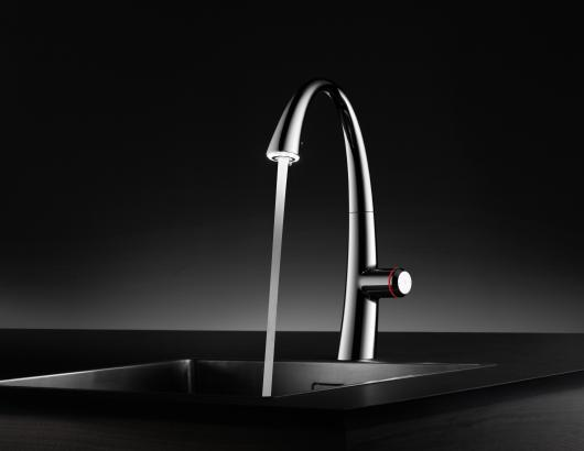 The faucet used to be a utilitarian water-spouting spigot and the kitchen was a place to grab a meal, but now the kitchen is the heart of the home, and its designs are driving faucet details.  Kitchen designs from California to Massachusetts are trending transitional and contemporary, and faucets are sleeker and taller as a result.