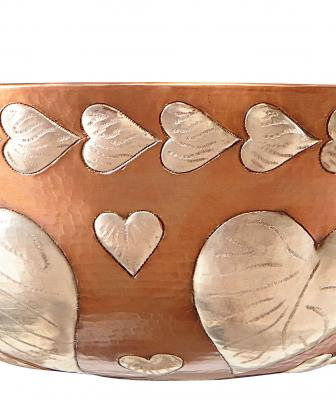 The Milagro sink is designed to recognize a church where women in the manufacturer's family get married. Made from 18-gauge hand-hammered copper, the sink features nickel heart-shaped embossing and comes with a coordinating drain assembly. It has an outer dimension of 15½ inches, an inner measurement of 13½ inches, and a depth of 5½ inches.